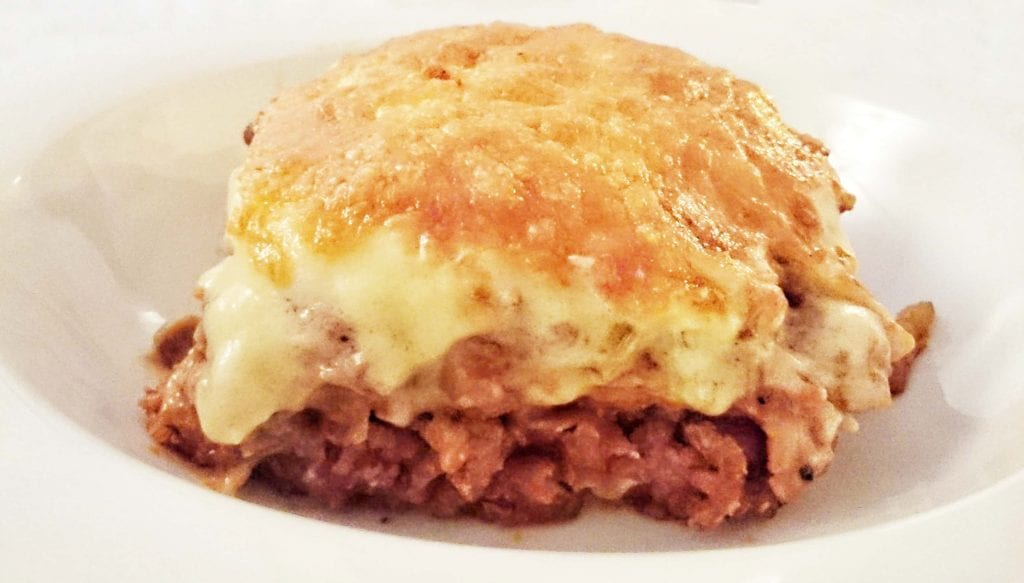 Travel by Taste by eating lasagna